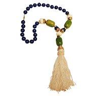 Unsigned Cadoro necklace Bakelite beads nylon tassel pendant