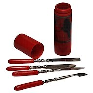 Early red plastic pocket manicure set silver black butterfly
