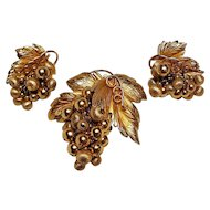 Napier dangling bunch of grapes pin and clip earrings set