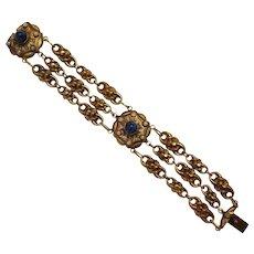 Hollow brass link bracelet lapis blue glass cabochon