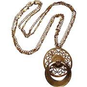 Monet door knocker pendant on two strands gold tone  chain