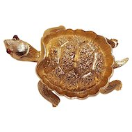 Trifari turtle pin red glass eyes