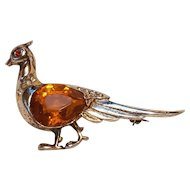 Reja sterling silver pheasant pin honey amber glass stone