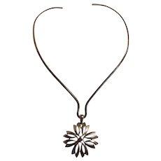 Trifari silver tone choker with a maltese cross like drop pendant
