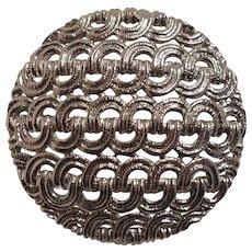 Monet circle pin with a pierced work design