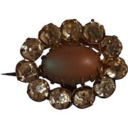 Saphiret glass pin oval with rhinestone frame