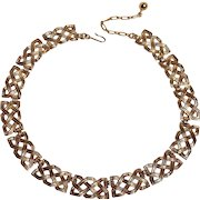 Trifari gold tone choker necklace with a woven motif