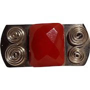 Faceted red Bakelite stone on metal pin circa 1940's