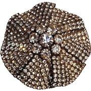 Rhinestone pin pinwheel like design silver tone
