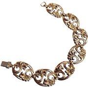 Symmetalic sterling silver 14K bracelet repousse work plaques