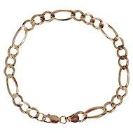 10K Yellow gold figaro chain link bracelet 5 grams