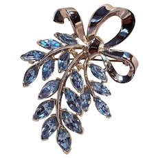Trifari blue navette rhinestone pin bouquet tied by a ribbon