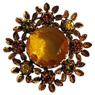 Austria rhinestone pin flower head honey amber glass center