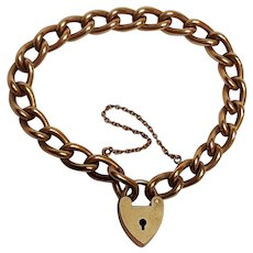 Curb link charm bracelet heart padlock clasp gold plated brass