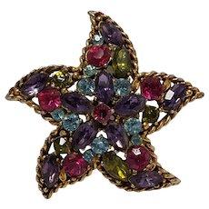 Regency rhinestone starfish pin multi color stones