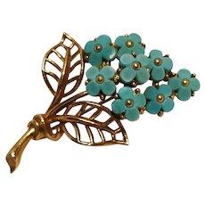 Trifari bouquet of flowers pin molded blue plastic