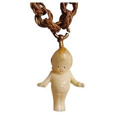 Kewpie doll charm pendant on a woven sweet grass chain