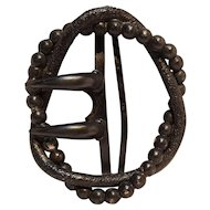 Antique embossed  buckle or clasp with a gun metal finish