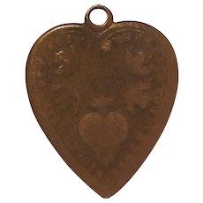 Antique bronze Sacred heart of Jesus devotional medal doves