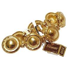 Monet articulated hammered disks bracelet never used
