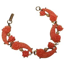 Coral colored celluloid bracelet molded roses simulated seed pearls