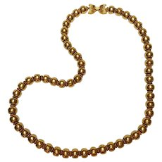 Trifari golden bead necklace fold over clasp