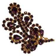 Vintage rhinestone pin purple blossom on a leaf