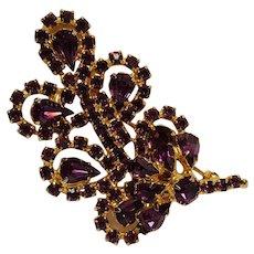 Vintage rhinestone pin purple blossom on a leaf