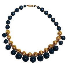 Napier necklace embossed gold tone metal and teal lucite beads