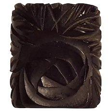 Black Bakelite ring deeply carved rose design