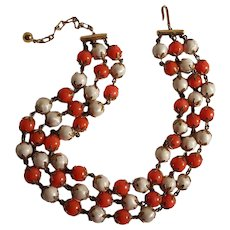 Trifari bead necklace three strand simulated pearl orange lucite