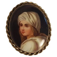 Antique painted porcelain portrait pin girl with white head covering