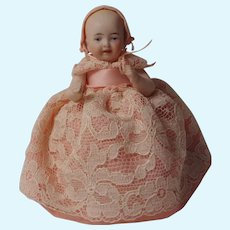 Bisque half doll pin cushion wire jointed arms pink dress lace