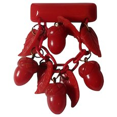 Carved red Bakelite acorn pin celluloid chain plastic leaves