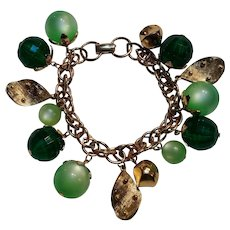 Coro chunky charm bracelet green moonglow lucite faceted plastic