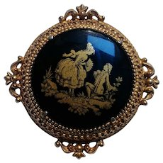Florenza pin courting couple gold silhouette on black glass