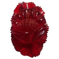 Carved red Prystal Bakelite dress clip flower