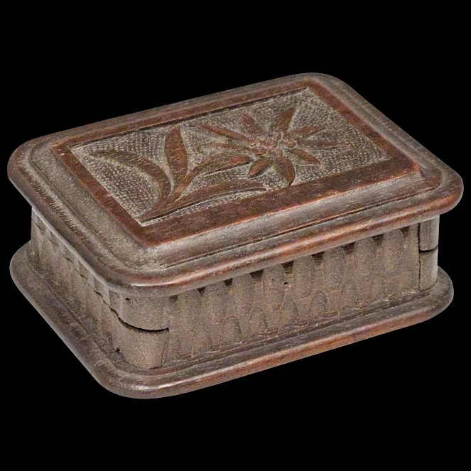 Black forest stamp box with carved edelweiss flower and