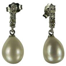 14k Diamond and Freshwater Cultured Pearl Earrings.