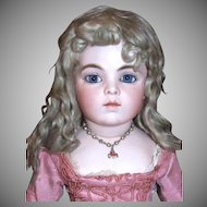 Vintage doll necklace