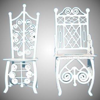 Pair of ornate white vintage metal doll chairs