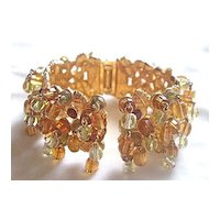 Chunky crystal dangles and rhinestone clamper bracelet