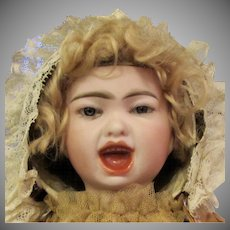 "18"" Rare French bisque double-faced bebe by Emile Jumeau from ""Series Fantastique""."