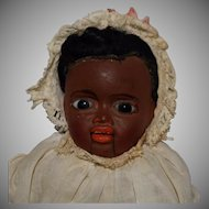 Brown German Papier Mache Baby with Mouth Mechanism