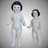 Two Small German China Frozen Charlotte Bathing Dolls