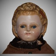 Wax over Composition Head Doll with Fancy Hairstyle