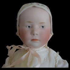 Heubach German Bisque Head Character Stuart Baby with Molded Bonnet