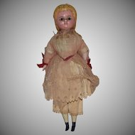 Antique Wax over Composition Blonde Doll in Original Dress