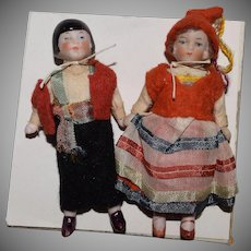 German All Bisque Doll Pair in Ethnic Costumes with One Asian Doll