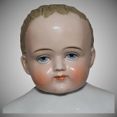 German Badekinder Frozen Charlie China Doll with Rare Blue Eyes